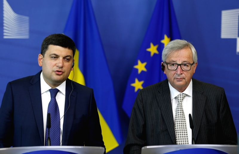 BRUSSELS, July 19, 2016 - Ukrainian Prime Minister Volodymyr Groysman(L) and European Commission President Jean-Claude Juncker attend a press conference after their meeting at the EU headquarters in ... - Volodymyr Groysman