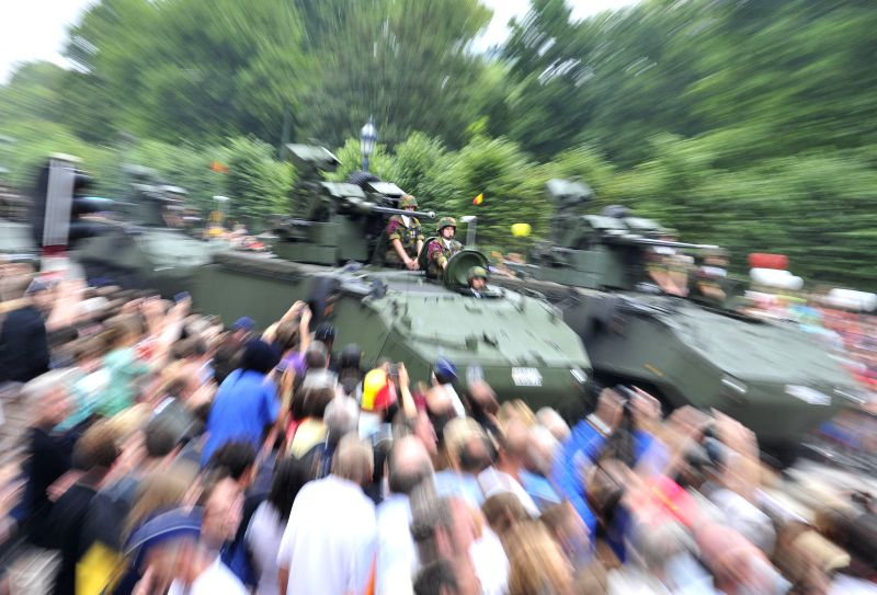 Armed vehicles attend the National Day millitary parade in Brussels, Belgium, on July 21, 2014.