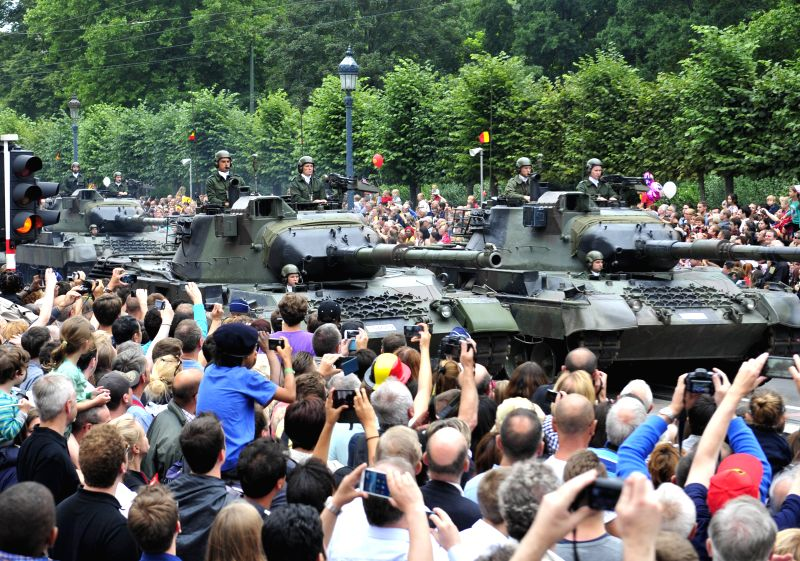 Tanks attend the National Day millitary parade in Brussels, Belgium, on July 21, 2014.