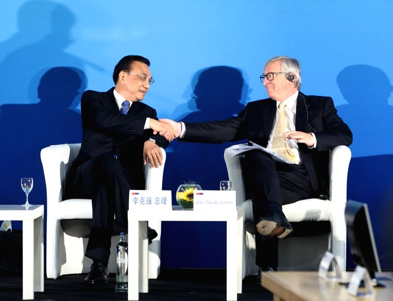 BRUSSELS, June 2, 2017 - Chinese Premier Li Keqiang (L) and European Commission President Jean-Claude Juncker attend the 12th EU-China Business Summit in Brussels, Belgium, June 2, 2017.