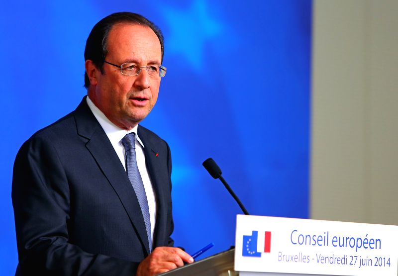 French President Francois Hollande holds a press conference after a European Union (EU) summit meeting in Brussels, Belgium, on June 27, 2014. The EU leaders ...
