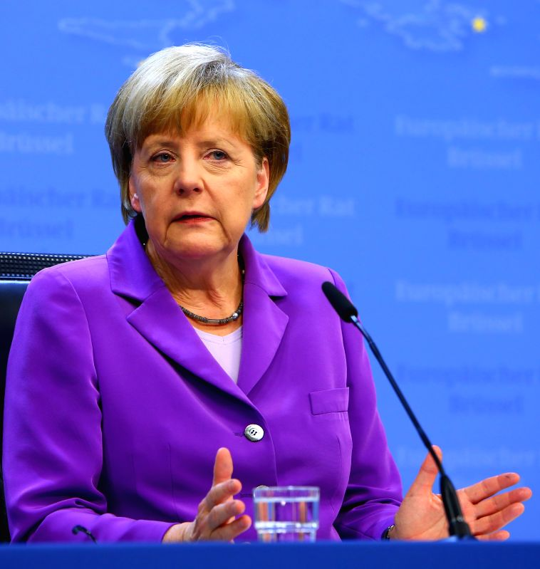 German Chancellor Angela Merkel holds a press conference after a European Union (EU) summit meeting in Brussels, Belgium, on June 27, 2014. The EU leaders ...