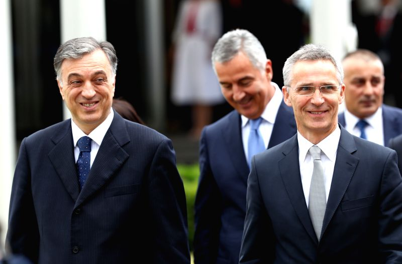 BRUSSELS, June 7, 2017 - Montenegrin President Filip Vujanovic (L, front) and NATO Secretary General Jens Stoltenberg (R, front) attend a ceremony marking Montenegro's accession to NATO at NATO ...