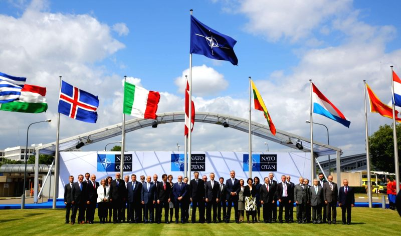 BRUSSELS, June 7, 2017 - Officials of NATO and representatives of its members pose for a group photo during a ceremony marking Montenegro's accession to NATO at NATO headquarters in Brussels, ...