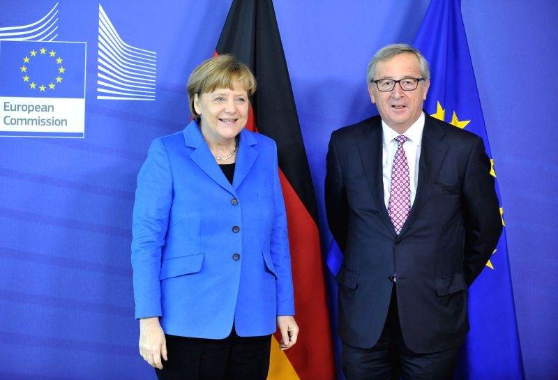 German Chancellor Angela Merkel (L) and European Commission President Jean-Claude Juncker pose for photos in Brussels, Belgium, on March 4, 2015. German Chancellor ...