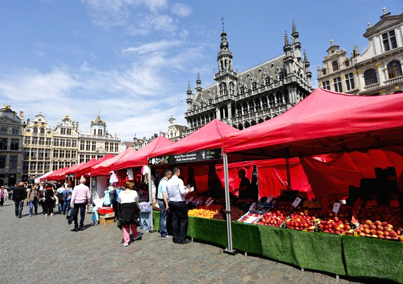 BRUSSELS, May 11, 2017 - People shop at the Grand Place in downtown Brussels, Belgium, May 11, 2017. The city of Brussels participated in a so-called 'I love my market' campaign, which puts the 15 ...
