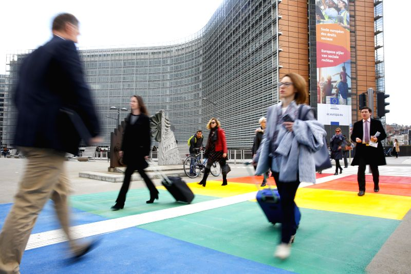 BRUSSELS, May 11, 2017 - People walk on pedestrian crossing in the colors of the rainbow flag in front of European Commision building in Brussels, Belgium, May 11, 2017. (Xinhua/Ye Pingfan)