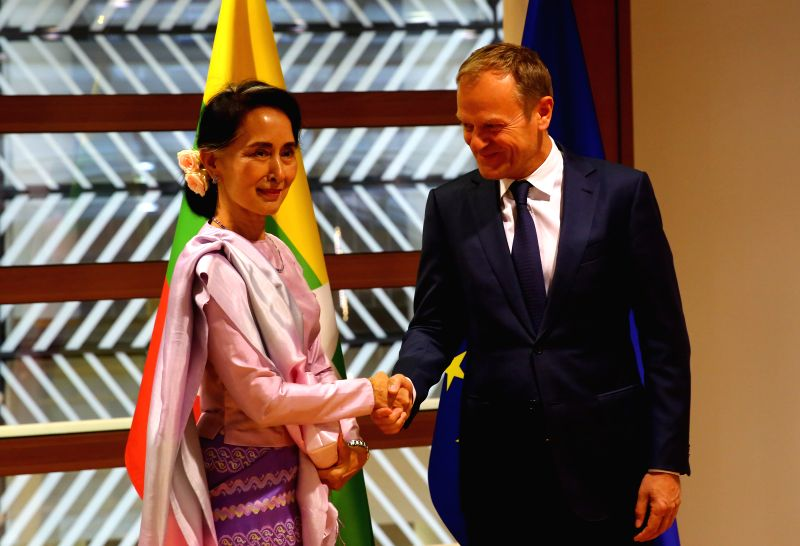 BRUSSELS, May 2, 2017 - European Council President Donald Tusk (R) shakes hands with visiting Myanmar State Counselor Aung San Suu Kyi at the Europa building in Brussels on May 2, 2017.