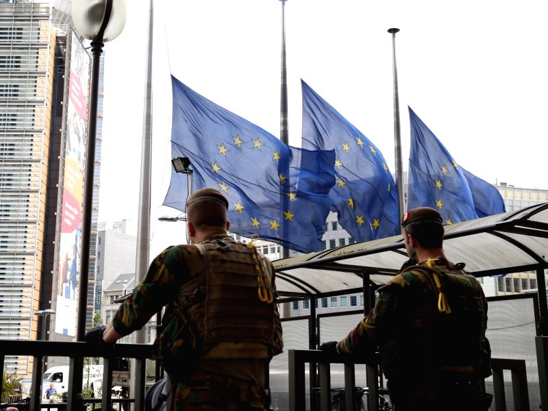 BRUSSELS, May 23, 2017 - European Union flags are lowered to half mast as soldiers guard outside the European Council headquarters in solidarity with the victims and their relatives of the terror ...