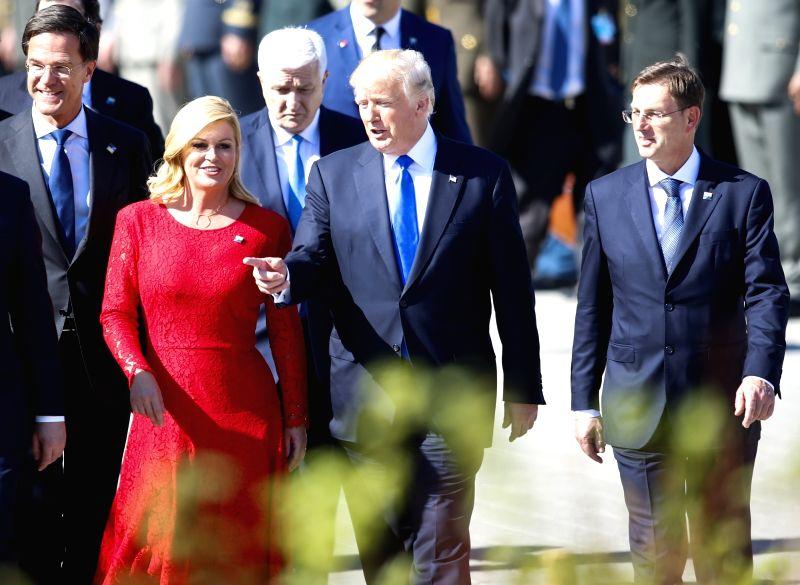 BRUSSELS, May 25, 2017 - Croatian President Kolinda Grabar-Kitarovic (L, front), U.S. President Donald Trump (C, front) and Slovenian Prime Minister Miro Cerar (R, front) walk to attend the handover ... - Miro Cerar