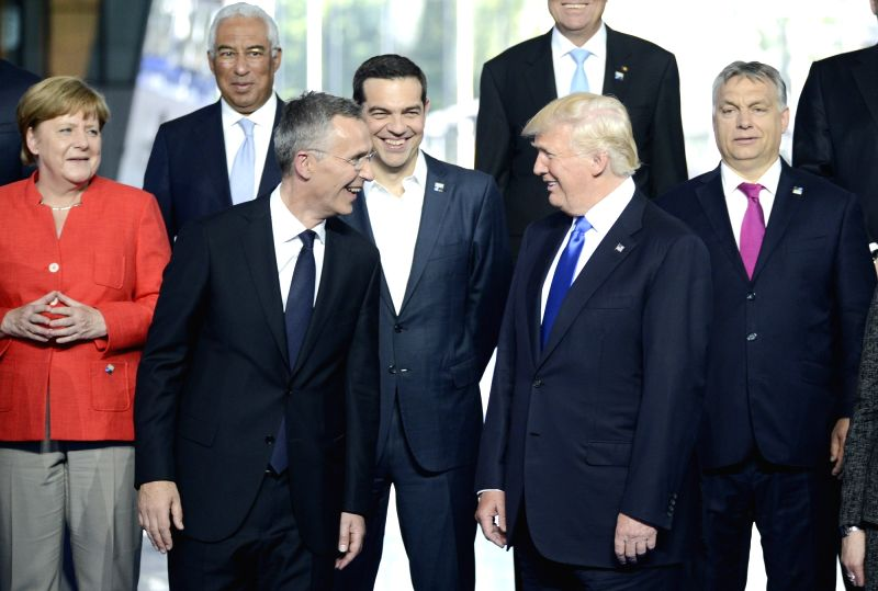 BRUSSELS, May 25, 2017 - NATO Secretary General Jens Stoltenberg (L, front) talks with U.S. President Donald Trump (R, front) at a family photo session during a one-day NATO Summit, in Brussels, ...