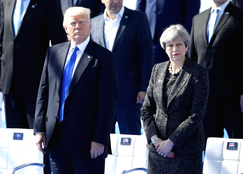 BRUSSELS, May 25, 2017 - U.S. President Donald Trump (L) and British Prime Minister Theresa May (R) attend the handover ceremony of the new NATO headquarters during a one-day NATO Summit, in ... - Theresa May