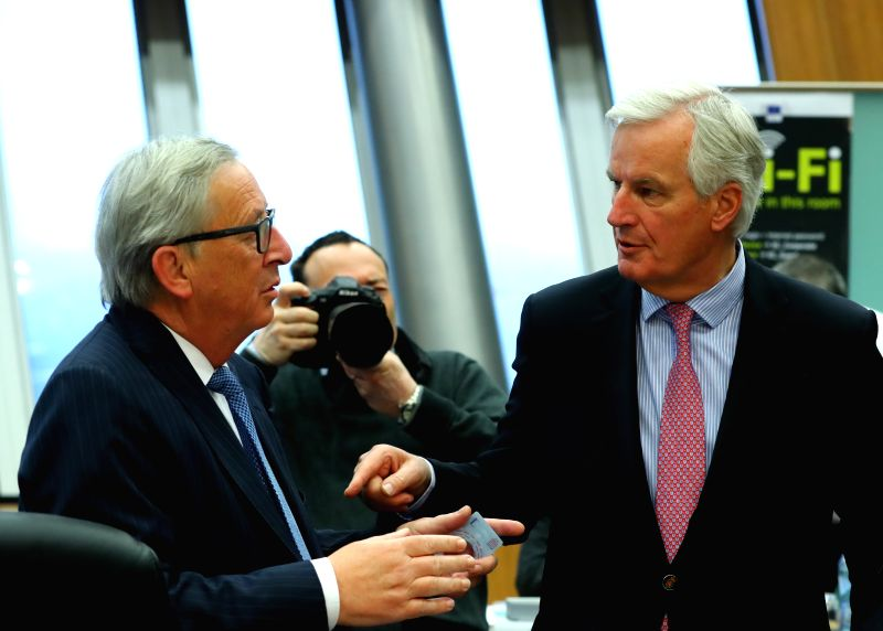 BRUSSELS, May 3, 2017 - European Commission President Jean-Claude Juncker (L) talks with Michel Barnier, EU's chief Brexit negotiator, prior to a meeting at EU headquarters in Brussels, Belgium, May ...