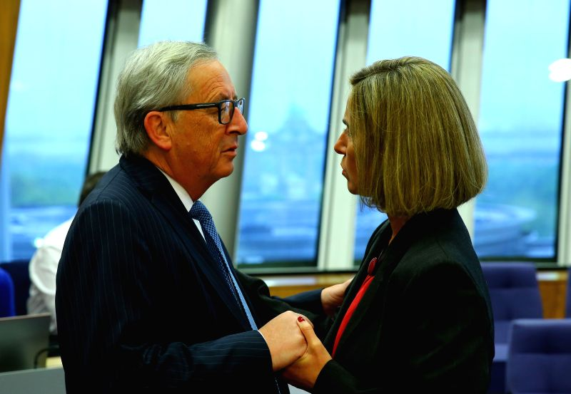 BRUSSELS, May 3, 2017 - European Commission President Jean-Claude Juncker (L) talks with Federica Mogherini, the EU's High Representative for Foreign Affairs and Security Policy, prior to a meeting ...