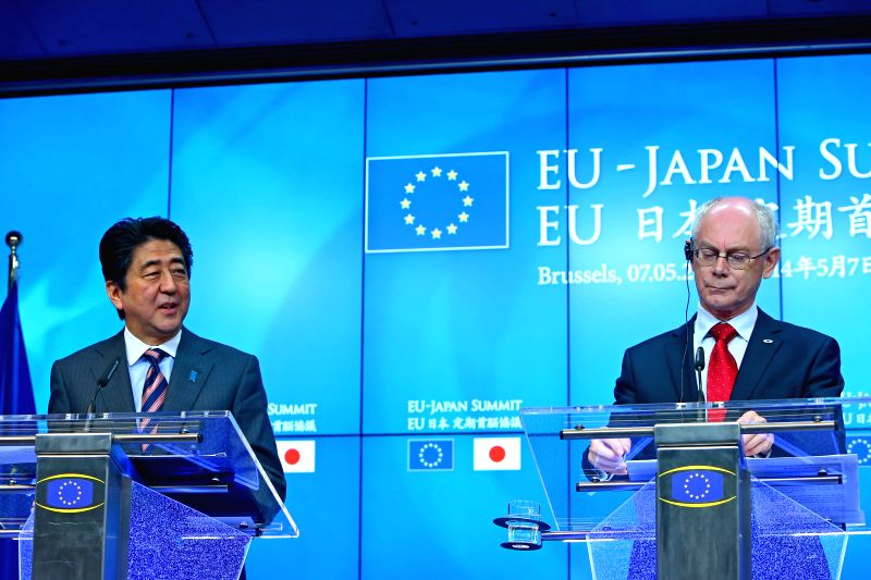 European Council President Herman Van Rompuy (R) attends a joint press conference with Japanese Prime Minister Shinzo Abe and European Commission (EC) President Jose - Shinzo Abe