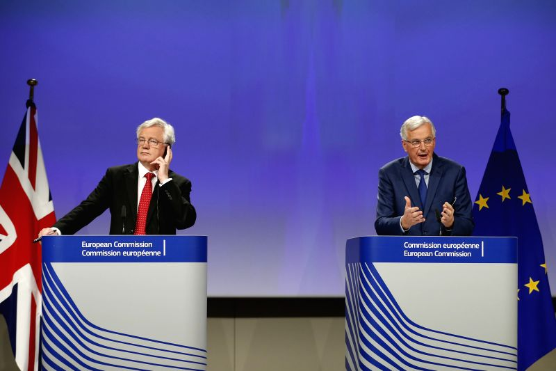 BRUSSELS, Oct. 12, 2017 - Britain's Brexit Secretary David Davis (L) and European Union (EU) chief negotiator Michel Barnier attend a press conference at the end of the fifth round of Negotiation on ...