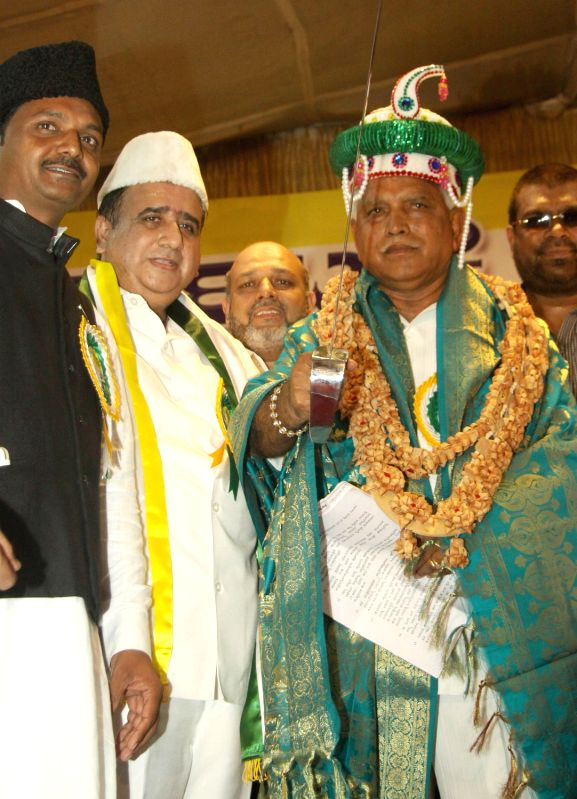 BS Yeddyurappa, KJP State President being felicitated by Syed Nizam Ali, KJP Leader and others, during the Karnataka Janatha Paksha Minority Convention at Palace Grounds in Bengaluru on March 30, ...