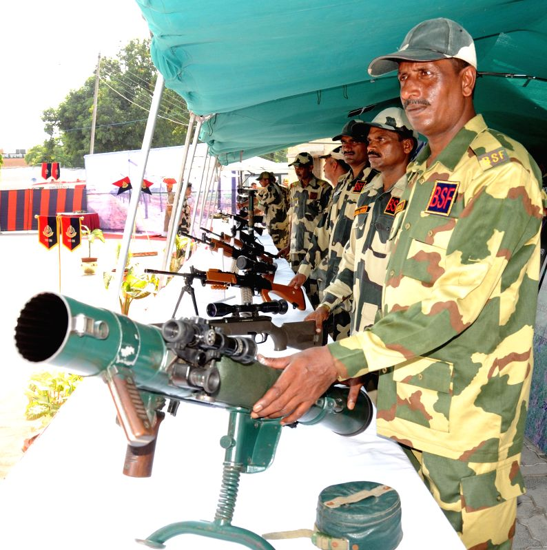 BSF jawans during an arms exhibition organised by BSF at Attari land border (Indo Pakistan border), Punjab ahead of Independence Day on Aug 13, 2014.