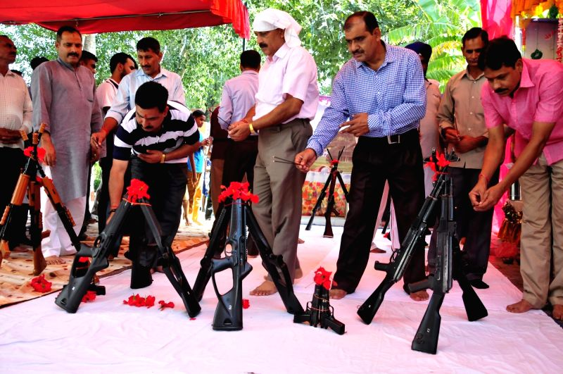 BSF officials perform Shastra Puja - worship weapons - on Vijaya Dashmi in Khasa near Amritsar on Sept 30, 2017.