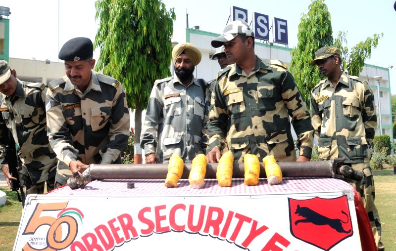 BSF officials present before press 6 packets of heroin -weighing approximately 3.8 kg- seized from Ghoga Border outpost  in Amritsar on May 10, 2016.