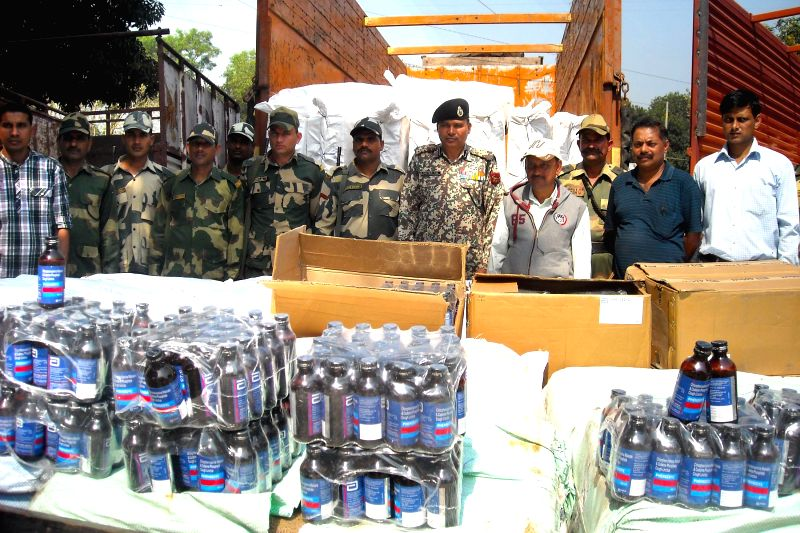 BSF officials present before press cough syrup bottles worth Rs One crores that was seized from Bhagalpur border outpost, near Agartala on March 15, 2015. The cough syrups were being smuggled to ...
