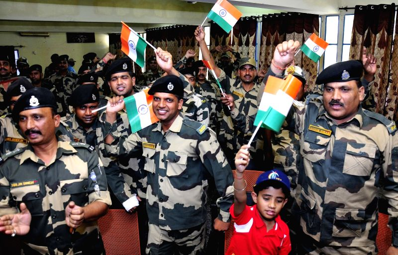 BSF personnel cheer for India as they watch ICC Champions Trophy match between India and Pakistan at BSF headquarter in Khasa near Amritsar, on June 4, 2017.