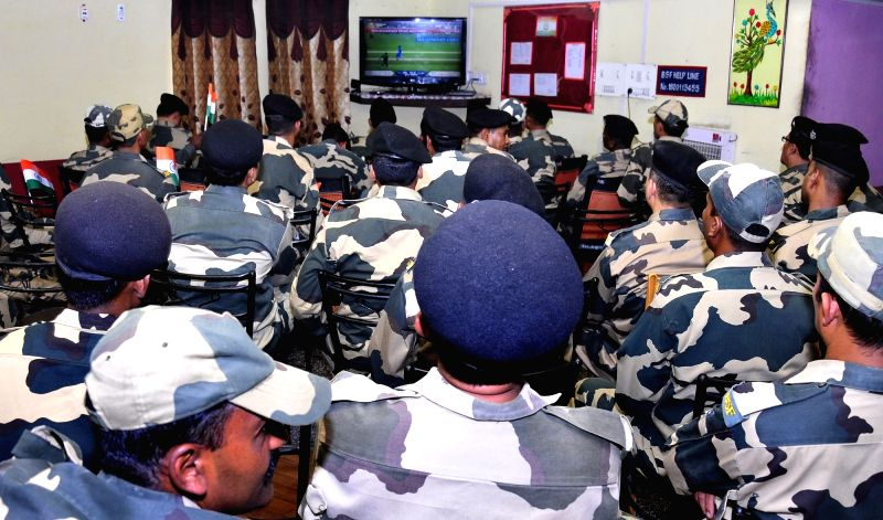 BSF personnel watch the ICC Champions Trophy match between India and Pakistan at BSF headquarter in Khasa near Amritsar, on June 4, 2017.