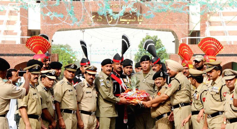 BSF Punjab frontier Inspector General (IG) Ashok Kumar greets Pakistani Rangers wing Commander Mohammad Asher Khan with sweets and fruits on 68th Independence Day celebrations near Indo-Pak border in - Ashok Kumar and Mohammad Asher Khan