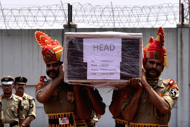 BSF soldiers carry the coffin of martyred BSF head constable Prem Sagar in New Delhi on May 2, 2017.