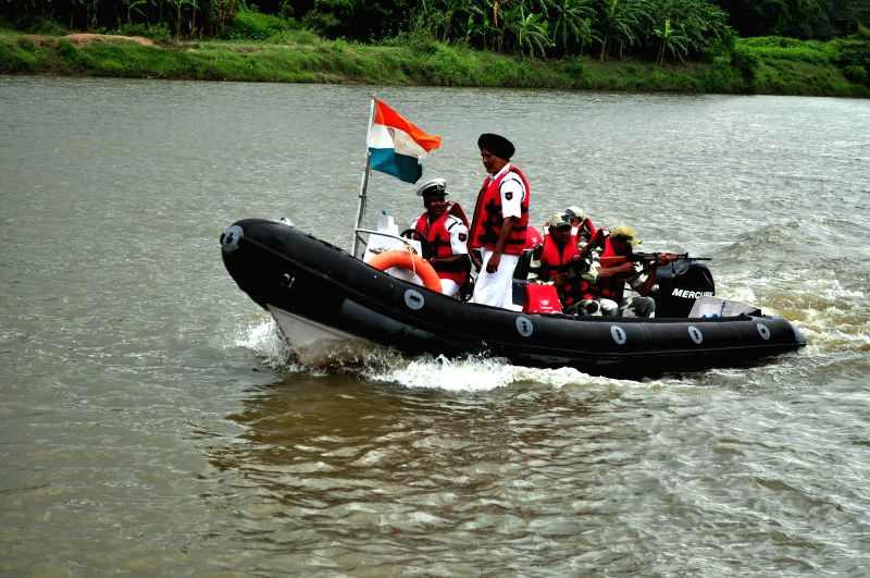 BSF soldiers patrol Gomati river near Indo -Bangladesh border in Sonamura, some 60 km away from Agartala on Aug 11, 2014.Union Home ministry has issued an alert regarding probable terror attacks in ..