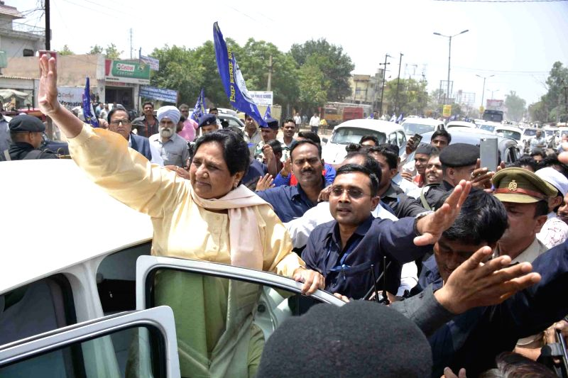 BSP chief Mayawati waves at her supporters in Ghaziabad on May 23, 2017.