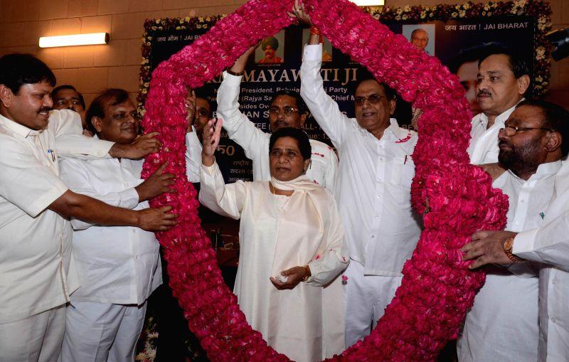 BSP chief Mayawati with party workers during a programme in Lucknow on Aug. 30, 2014.