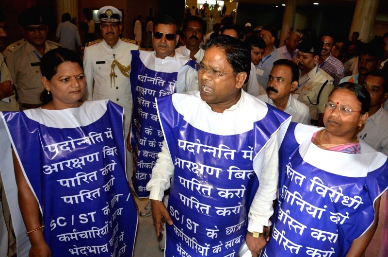 "BSP workers stage a demonstration to press for ""Promotion Reservation"" at Madhya Pradesh Assembly in Bhopal on July 27, 2016."