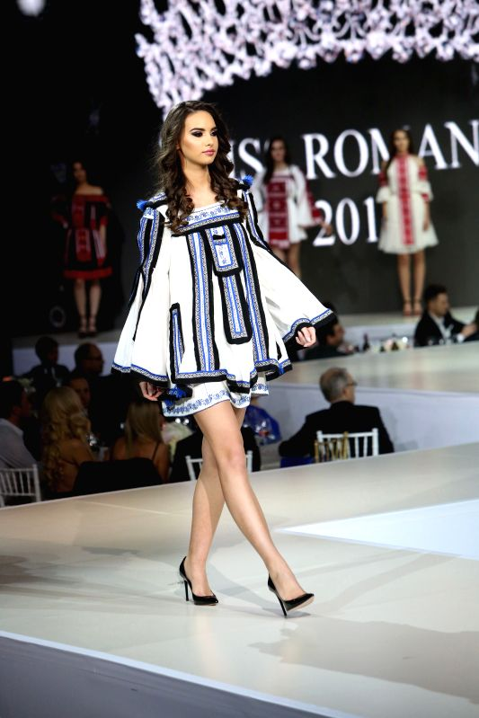 BUCHAREST, Dec. 5, 2017 - A participant attends the competition of Miss Romania 2017 in Bucharest, Romania, on Dec. 4, 2017.