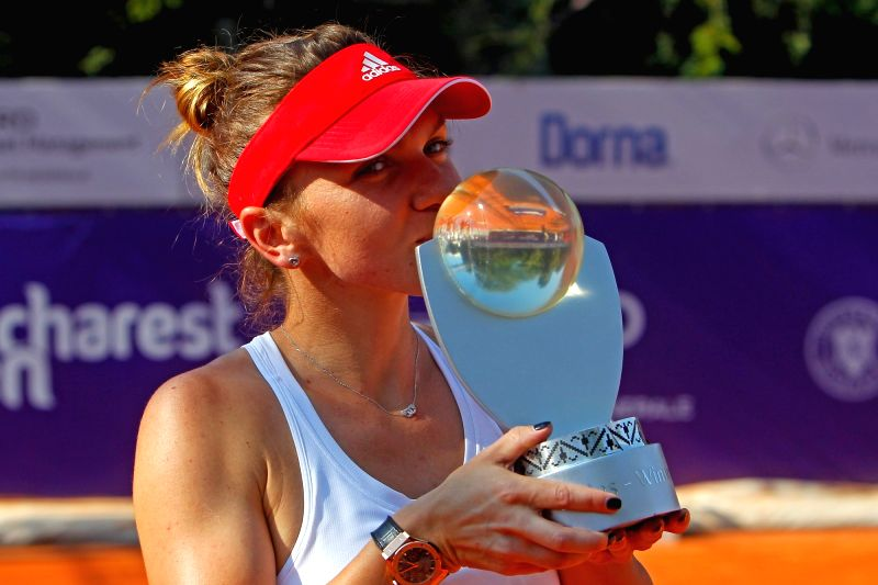 BUCHAREST, July 18, 2016 - Simona Halep of Romania kisses the trophy after defeating Anastasija Sevastova of Latvia in the women's singles final match at the Bucharest Open WTA tournament in ...