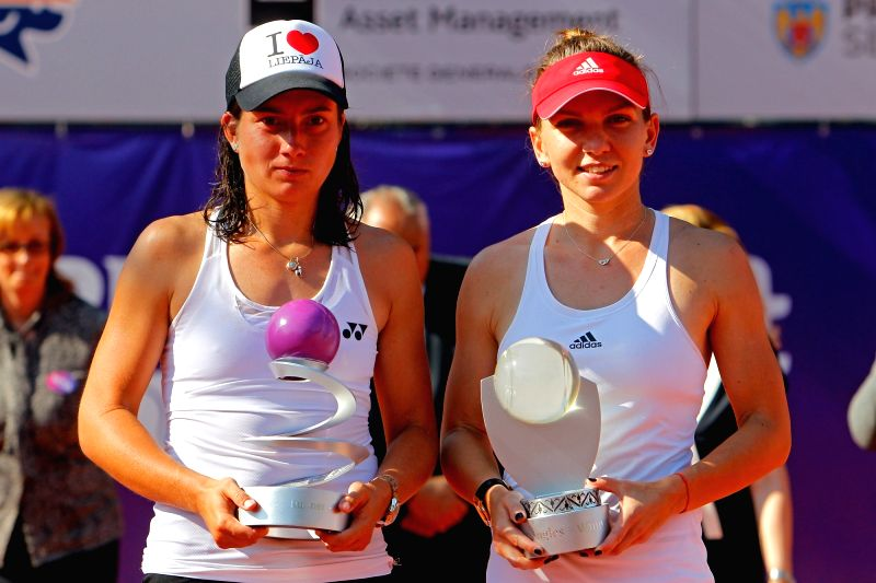 BUCHAREST, July 18, 2016 - Simona Halep (R) of Romania and Anastasija Sevastova of Latvia pose during the awarding ceremony for the women's singles at the Bucharest Open WTA tournament in Bucharest, ...