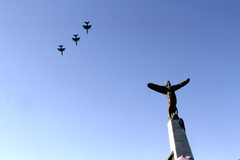 Romanian military airplanes fly over the pilot's monument during the ceremony celebrating the Air Force Day, at the Air Heroes Monument, in Bucharest, capital of .