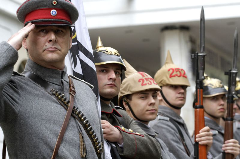 People in WWI military uniforms of the country participate in a parade at the National Military History Museum to mark the centenary of WWI in Bucharest, Romania, .