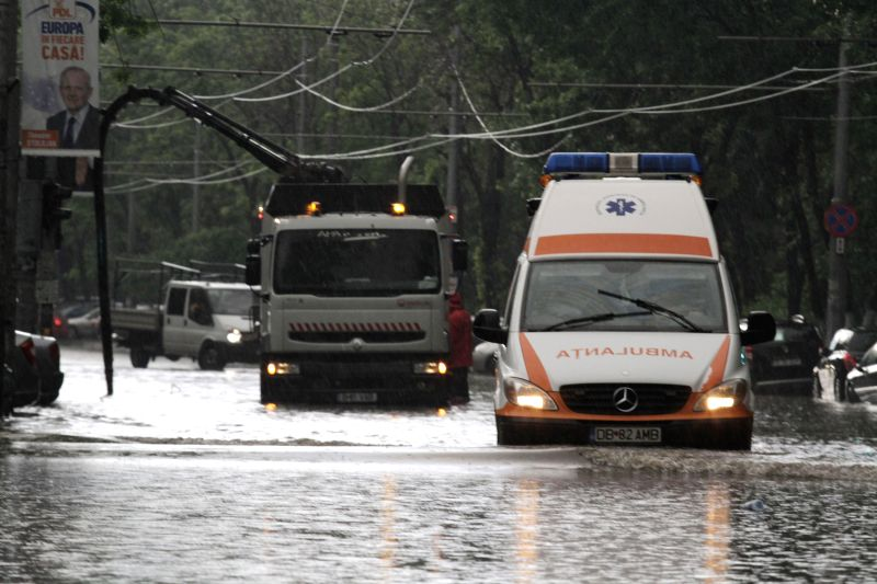 A street is flooded after a thunder storm and hail hit Bucharest, capital of Romania, May 4, 2014.