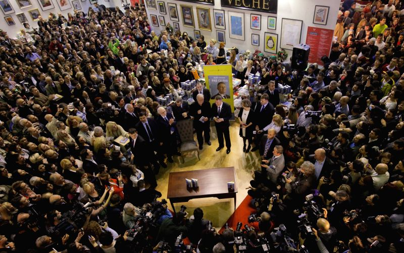 """Romania's president elect Klaus Iohannis presents his autobiographic volume """"Step by Step"""" at the Internal Book Fair Gaudeamus, in Bucharest, capital of Romania, Nov. 19, 2014. .."""