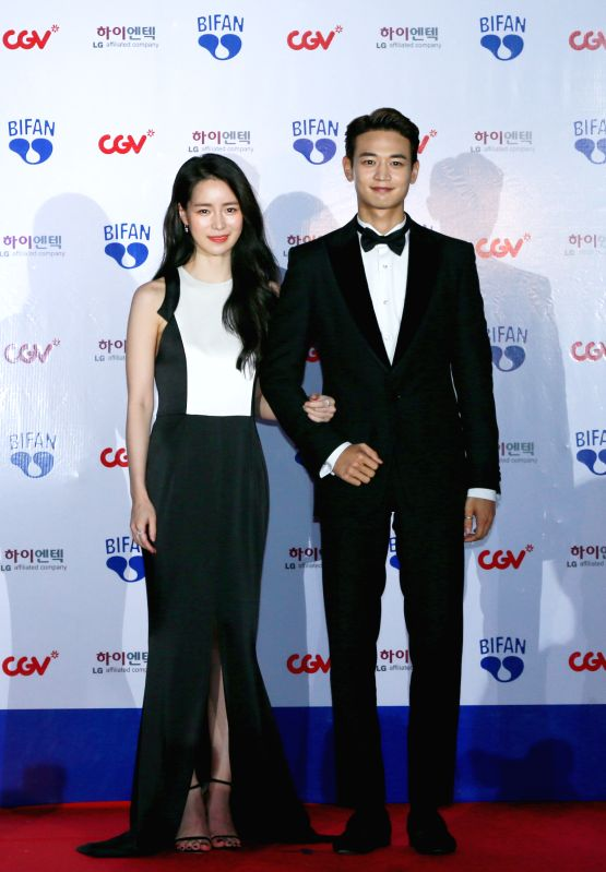 BUCHEON (SOUTH KOREA), July 12, 2018 South Korean singer Choi Min-ho (R) and actress Lim Ji-yeon appear at the 22nd Bucheon International Fantastic Film Festival red carpet in Bucheon, ... - Lim J