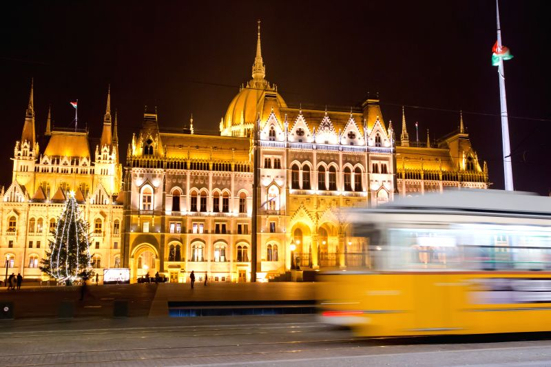 A Christmas tree with lights stands in front of the Hungarian Parliament in Budapest, Hungary on Dec. 10, 2014.
