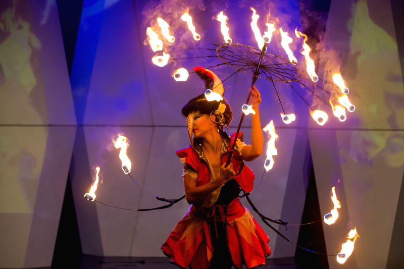 A fire juggler from the Magma Fire Theatre of Hungary performs during the Budapest Fashion Week held in Budapest, Hungary on Nov. 26, 2014. )