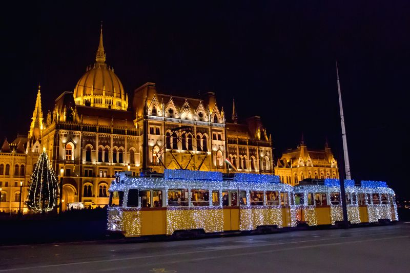 A tram covered with led-lights passes through Kossuth Square where the Parliament building stands in central Budapest, Hungary on Dec. 11, 2014.