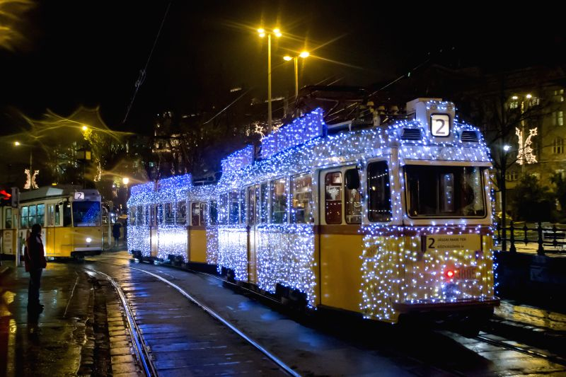 A tram is wrapped up with Christmas lights in Budapest, Hungary, on Dec. 8, 2014.