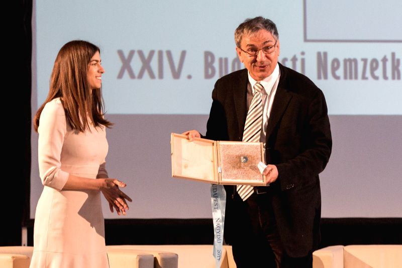 BUDAPEST, April 20, 2017 - Turkish winner of Nobel Prize in Literature Orhan Pamuk (R) receives the Budapest Grand Prize on the opening day of the 24th Budapest International Book Festival in ...