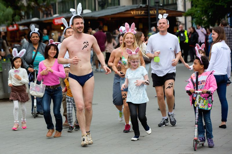 """People participate in the first half naked """"Bunny run"""" to support a charity in Budapest, Hungary, on April 21, 2014. The participants voluntarily run at"""
