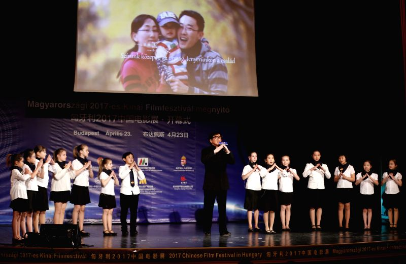 BUDAPEST, April 24, 2017 - Movie star Jackie Chan (C) and students from the Hungarian-Chinese Bilingual Primary and Secondary School attend the opening ceremony of the 2017 Chinese Film Festival at ...