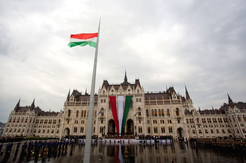 Flag-raising ceremony is held in Kossuth square in front of the Hungarian Parliament building to celebrate Hungarian national holiday in Budapest, Hungary, on Aug.