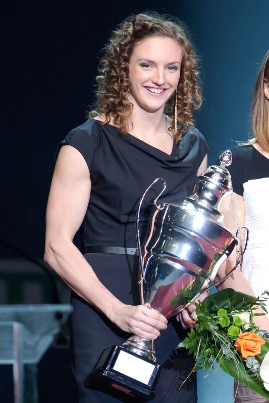 Hungarian swimmer Katinka Hosszu poses with the trophy for the Hungarian sportswoman of the year 2013. in Budapest Dec. 19, 2013. Hungarian sports journalists